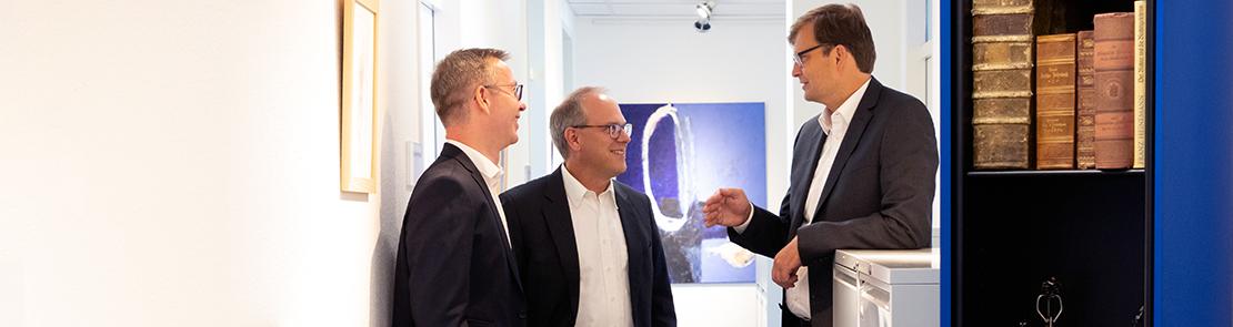 Dr. Rothhaupt, Dr. Faigle und Herr Kittel im Gespräch
